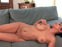 Adorable Aria Giovanni poses her huge boobs while gently stimulating her wet vag