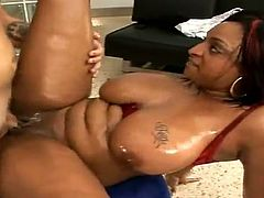 Curvy ebony mulf Carmen Hayes shows her massive natural tits to a white guy and lets him rub his dick against the jugs. Then they bang in cowgirl and other positions and the bitch moans crazily with pleasure.