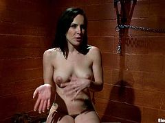 Sexy brunette in the stocks gets tortured with electricity by Bobbi Starr. Later on Katie also sucks big electro dildo and licks Bobbi's vagina.