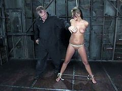 Stunning chick with perfect boobs gets tied up and gagged. Then a guy pinches her nipples with claws and toy the pussy.