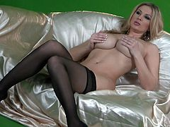 Amazingly hot blonde MILF with big boobs poses for a camera in stockings and black lingerie. Then this hottie also fingers her wet pussy.