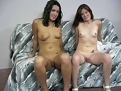 Two dark-haired chicks are playing lesbian games in a homemade clip. One of the bitches suck her GF's toy and then welcomes the strapon in her pink cave.