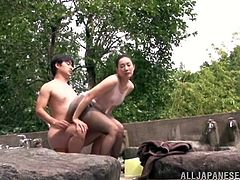 Mika Nanase head to an outdoor public bath, where she washes her husband naked body with soap. She rubs her round ass all over his stiff cock, that's covered in soap.