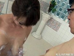 She's busty and loves to bath with her man. The sexy mature whore has foam all over her body and her soaped boobs are perfect for a titjob. She taunts this guy and slide her boobs on his body, before kneeling, to give him a titjob. Yeah, this is surely something, that deserves to be watched.