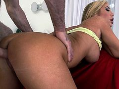 Smoking hot blonde babe with killer body shape stands on her all four serving her coochie from behind. She sighs with pleasure when big hard flesh enters her clam. Horny bitch gets fucked really bad doggy style.
