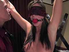 Cute brown-haired chick Angelica Saige is having fun with Mark Davis in a living room. She gets bound by the man and then gets her snatch rubbed with a dildo and fucked hard.