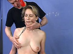 Blonde chick gets undressed and hog tied by her unmerciful master. Then she suspends a girl and puts a gag in her mouth. After that she gets her pussy fingered and wired.