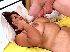 A chubby dark-haired woman sucks her man's prick and rubs it in between her massive tits. Then she takes the schlong into her cunt and gets it pounded in missionary position.