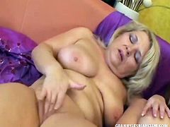 Claudie and Karen are dressed to the nines in heels, fancy lingerie, and feather boas. After all, these lesbian grannies still got it where it counts! Sexy blond Claudie pops out one of her boobs for Karen to suck on. Obediently, Karen bends ove