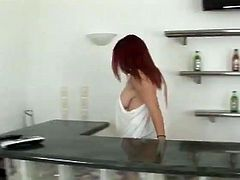Gorgeous redhead babe with big boobs gives passionate blowjob and gets fucked reverse cowgirl. After that she also gets titty fucked.