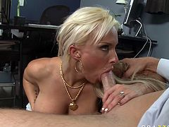 Horny MILF with huge boobs seduces the guy for sex in the office. She exposes her succous big boobs so he goes hard as hammer right away. Holly reveals hard flesh out of his pants and starts sucking the rod greedily.