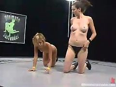 Kat loses the fight to Spider because she is much weaker. After the fight Kat gets her pussy toyed deep and hard with a strap-on.