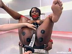 Hot ebony slut Jada Fire is having fun with Princess Donna Dolore indoors. Donna binds and tornents Jada and then stuffs her poontang with a dildo and fucks it hard.