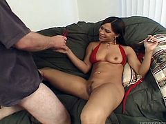 Naughty Latina in a bikini lies on a sofa and gives a blowjob to White dude. After that she spreads the legs and gets rammed in her wet pussy.