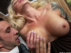 Busty blonde porn star Brooke Haven has dirty sex on a table in the office