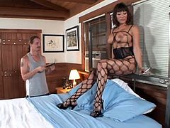 Stunning brunette milf puts that fishnet on and goes for his huge dagger! Ava Devine is her name and she is not letting him go for a while.