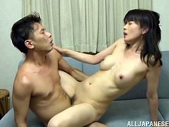 Hot Japanese milf Eriko Miura is having fun with her husband in the living room. She allows the guy to fondle her body and then they fuck in cowgirl and other positions on the sofa.