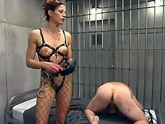 Kym Wilde is the bitch dominating a guy in this video, torturing his cock and strapon fucking his ass in this femdom BDSM vid.