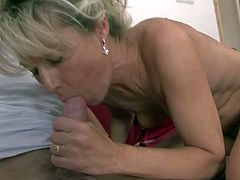 Mature cock loving milf wit no tits and great fucking skills seduces young blonde buck. She gives him lusty blowjob and enjoys riding on his pecker on casual afternoon.