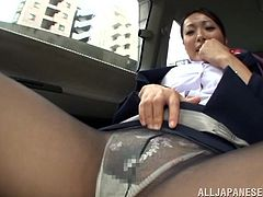 This Japanese milf is a stewardess on the way to the airport. The pilot is in the car with her. He rubs a vibrator all over her legs and chest, then gives it to her, so she can finish herself. She masturbates crazy until orgasm.