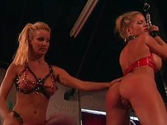 Two busty blonde bombshells are having lesbian BDSM fun indoors. They beat each other and then one of the hotties makes the other suck and ride her big strapon.