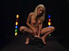Gorgeous blonde Hillary Scott shows her body for the cam and fondles herself. Then she sits down on a fucking machine and enjoys a raunchy moment.