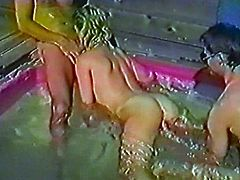 Take a look at this vintage video where a slutty blonde sucks and fucks two hard cocks in a threesome inside a jacuzzi.