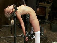 Sexy blonde girl takes her red dress off and gets ted up. Later on her master tortures her nipples with ropes and pumps. Then she gets toyed with a dildo and a vibrator at the same time.