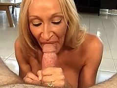 Blowjob is her specialty and this nasty and horny blonde MILF can make every dude insane, she is on her knees with big dick between her boobs.