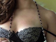 Luscious red haired babe is wearing tempting black lingerie. She lips the underwear down exposing her gorgeous body with soft silky skin. Sexy woman has got perky tits with firm nipples. Extremely arousing striptease video presented by Babes studio.