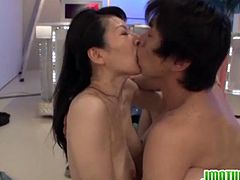 Fascinating and dirty-minded hot mature Japanese babe Hitomi Oohashi is very busy now, because she is in the middle of pleasuring her self with young cock.Watch her sucking and getting fucked by that young hard cock.