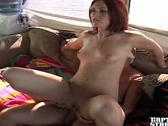 Slutty redhead girl gives a blowjob to boat captain. After that she lies down on a sofa and gets her shaved pussy drilled.