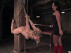 There's electrical torture, wild bondage and strapon fucking in store for Tawni Ryden in this lesbian femdom video..