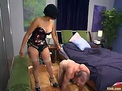 Billy Budd is playing BDSM games with nasty girl Mika Tan in a bedroom. Mika binds the guy and makes him lick her shoes and then pokes her strapon into his ass and mouth.