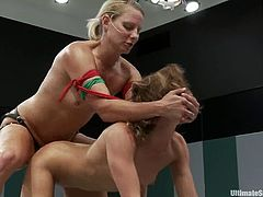Brown-haired milf Ariel X is having a tussle with Vendetta on tatami. The bitches fight with each other and then Ariel loses and lets Vendetta fuck her butt with a strapon.