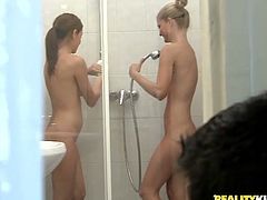 Slim girls from Europe take a shower together after a picnic. After they get fucked by two guys in a bedroom.