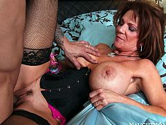 Deauxma is wearing tight corset and black nylon stockings. She is looking extremely hot and sexy. Voracious mommy is proud of her monster size boobs that she demonstrates in all the glory. Sultry mommy is getting fucked hard missionary style in arousing Naughty America porn clip.