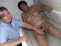 Spoiled whore carefully washed her lesbian friend's body with soothing warm water paying special attention to her fat pussy.
