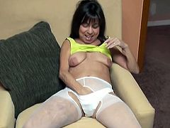 That time worn black haired whore will make you throw up. Mature skank in white pantyhose rubs dirty underwear all over her face and fucks her cunt with dildo.