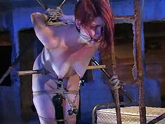 Sexy redhead chick Lilla Katt allows some dude to bind her in some weird place. The man immobilizes the chick and then pleases her with ardent toying.