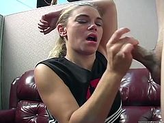 This kinky cheerleader keeps her uniform on while giving a guy head then she lifts her arm and lets him shoot his load into her armpits