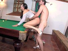 Long haired brunette with long legs and sexy glasses in white fishnet blouse only gets licked by Ian Scott and fucks with him like pro on billiard table.