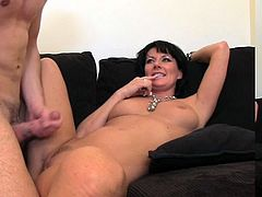 Curvy brunette mom pleases a young stud with a passionate blowjob. Then she sits down on his schlong and they have some naughty banging in cowgirl position.