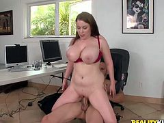 For this cock-loving cougar, the perfect start into the workday means giving her colleague titjob with her huge boobs, and mounting his erect dick.