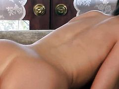 Emily Addison with big knockers and trimmed bush kills time fingering her butthole