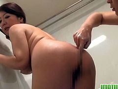 Watch this sexy busty and big ass Japanese mature with her young lover in shower,where he fingers her wet pussy and fucks her big boobs and creams her tits with his cumshot and she licks it all.