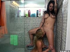 Brunette with big tits and hot blondie get it on in the shower, hit play and enjoy it right here, fucker! It's fuckin' free!
