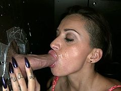 Since her guy can't be there with her, this boobalicious nympho needs a good, stiff cock to satisfy her hunger for sex. She needs it so bad that she goes to this gloryhole place where she knows she will find a big one sticking out of a hole.