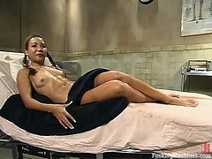 Petite Asian chick Keeani Lei shows what a nasty girl she is. She gets double penetrated by a fucking machine and seems to be unable to stop playing with it.