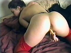 Sexy big-breasted chick wearing fishnet stockings is having fun in her room. She rubs her clit passionately and then finger-fucks her pink cave and gets a great orgasm.